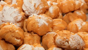 Profiteroles choux pastry buns with whipped cream Stock Photos