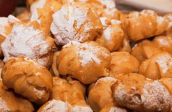 Profiteroles choux pastry buns with whipped cream Royalty Free Stock Images