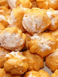 Profiteroles choux pastry buns with whipped cream Stock Image