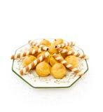 Profiteroles com os waffles no branco Imagens de Stock Royalty Free