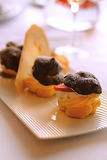 Profiteroles cookies filled with cream and strawbe stock photos