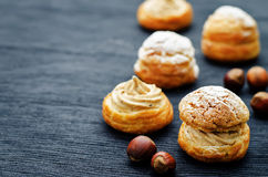 Profiteroles with cream with praline Royalty Free Stock Image