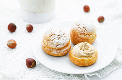 Profiteroles with cream with praline Royalty Free Stock Images