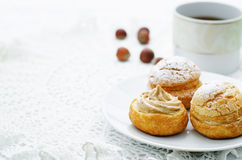 Profiteroles with cream with praline Stock Photography