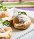 Profiteroles, cream puff, traditional French dessert Royalty Free Stock Photos