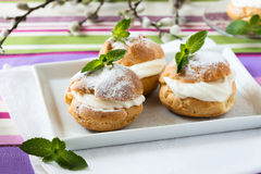 Profiteroles, cream puff, traditional French dessert Stock Photos