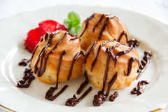 Profiteroles with cream Royalty Free Stock Images