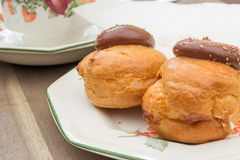 Profiteroles with a Cup Of Tea Stock Photo