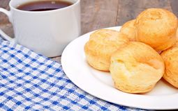 Profiteroles and a cup of tea Stock Photo