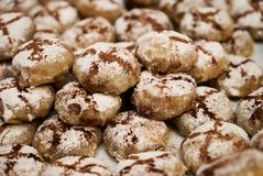 Profiteroles dessert cakes. With cream and chocolate, sprinkled with powdered sugar, close-up Stock Photo