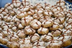 Profiteroles dessert cakes. With cream and chocolate, sprinkled with powdered sugar, close-up Royalty Free Stock Photography
