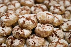 Profiteroles dessert cakes. With cream and chocolate, sprinkled with powdered sugar, close-up Stock Images