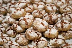 Profiteroles dessert cakes. With cream and chocolate, sprinkled with powdered sugar, close-up Royalty Free Stock Images