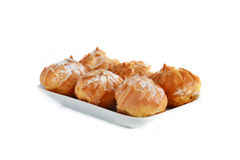 Profiteroles on the plate Royalty Free Stock Images