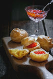 Profiteroles with red caviar Royalty Free Stock Photos