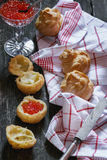 Profiteroles with red caviar Royalty Free Stock Image