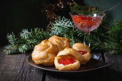 Profiteroles with red caviar Stock Images
