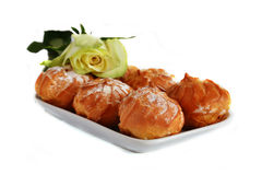Profiteroles and rose Royalty Free Stock Photography