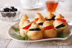 Profiteroles stuffed with red and black caviar, horizontal Royalty Free Stock Photo