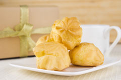 Profiteroles with Tea and gift Royalty Free Stock Photos
