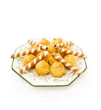 Profiteroles with waffles on white. Dish with creamy profiteroles and waffles isolated on white Royalty Free Stock Images