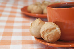 Profitroles and cup of tea Stock Images