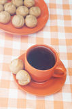Profitroles and cup of tea on tablecloth. Profitroles and cup of tea on the tablecloth stock images