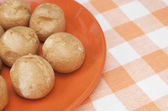 Profitroles in the plate on tablecloth Royalty Free Stock Photography