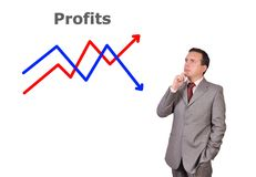 Profits. Pensive businessman looking at profits Royalty Free Stock Image