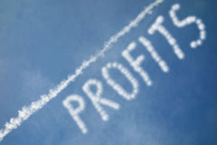 Profits. Clouds form an ascending line, with the word Profits written in the sky Royalty Free Stock Images