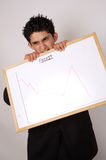 Profits forecast. Young male businessman not happy with the profits forecast stock image