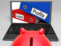 Profits And Looses Files On Laptop Shows Expenses Royalty Free Stock Images