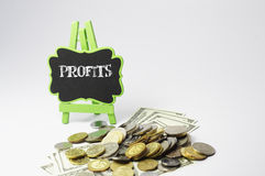 Profits Text and Money - Business Concept Stock Image
