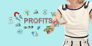 Profits text with young woman. On a blue background Royalty Free Stock Images