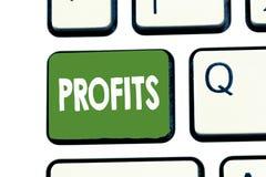 Profitti di rappresentazione della nota di scrittura La foto di affari che montra la differenza di beneficio finanziario fra l'im fotografie stock