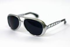 Profondità degli occhiali da sole del campo poco profonda Immagine Stock