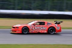 Proford mustang-raceauto op de cursus Stock Foto's