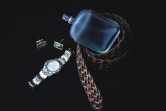 Profumo ed orologi maschii Immagine Stock