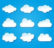 Progettazione delle nuvole su fondo blu Fotografia Stock
