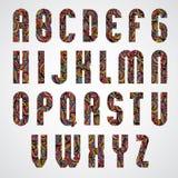 Progettazione di lettere condensata audace d'avanguardia di alfabeto decorata con il bea Fotografia Stock Libera da Diritti