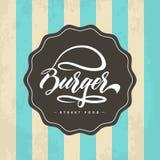 Progettazione di logo dell'alimento dell'hamburger dell'iscrizione della mano Immagine Stock Libera da Diritti