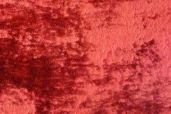 Progettazione luminosa dell'estratto di struttura del fondo del velluto rosso fotografie stock