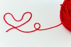 Progettazione rossa del filato di forma del cuore per amore Fotografia Stock