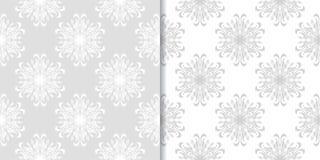 Progettazioni ornamentali floreali grigio chiaro Insieme dei reticoli senza giunte Immagine Stock