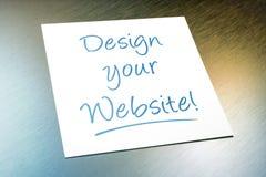Progetti la vostra menzogne di carta del sito Web sull'alluminio spazzolato del frigorifero Fotografie Stock