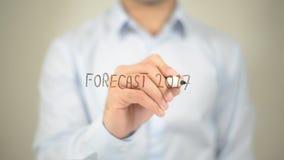 Prognose 2017, Mannschreiben auf transparentem Schirm Lizenzfreie Stockbilder