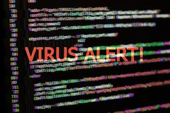 Program code with virus alert. Glitch effect added. Computer security concept. Program code with virus alert. Glitch effect added stock photos