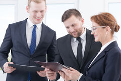 This is program of our corporate coaching. Mature women and two young men during corporate coaching Royalty Free Stock Image