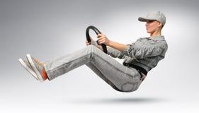 Programa piloto de coche de la muchacha con una rueda Fotografía de archivo libre de regalías