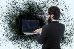 Programador com um port?til foto de stock royalty free